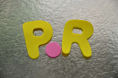 word pr on a silver photo