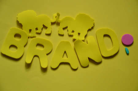word brand on a yellow photo