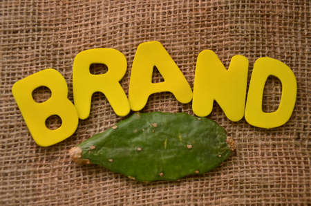 word brand on burlap background photo