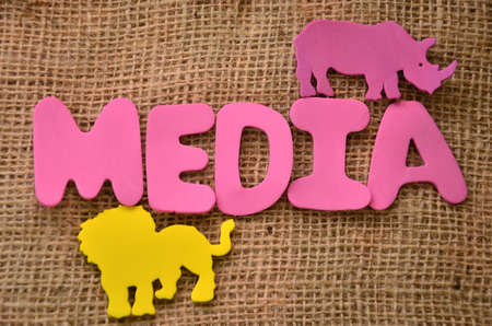 connectedness: word media on burlap background Stock Photo