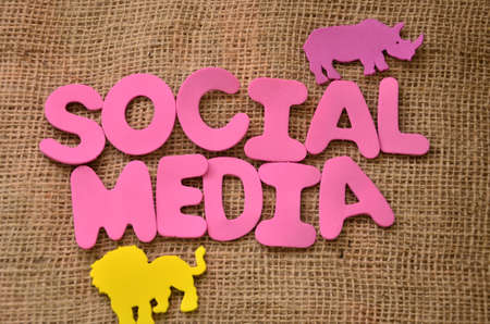 word social media on burlap background photo