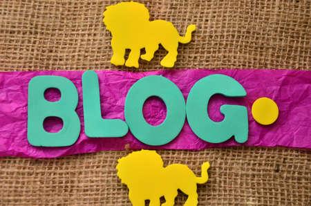 word blog on a burlap background photo