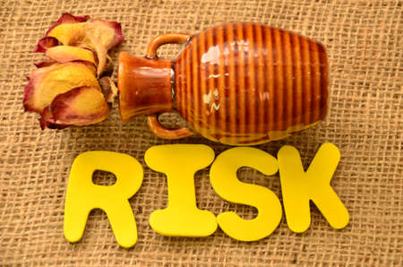 risk free: word risk on a burlap