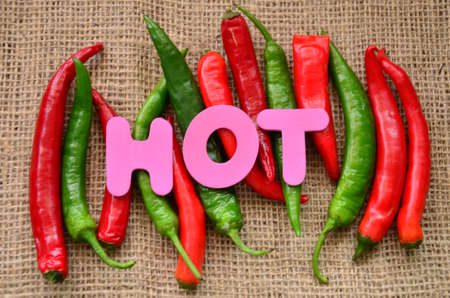 word hot and chili on a burlap photo