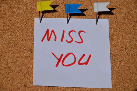yearn: the word miss you on the cork board Stock Photo