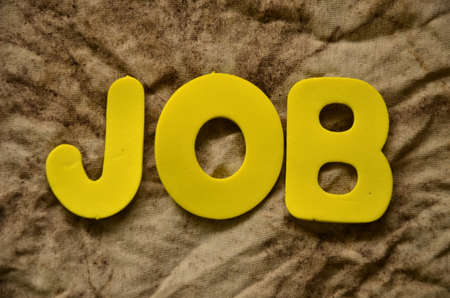 the word jobs against a very old fabric photo