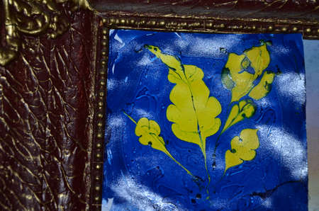 yellow leaf on a blue photo