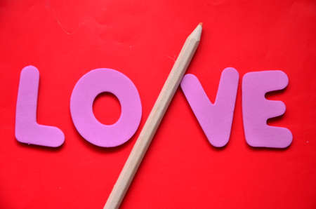 word love on a red photo