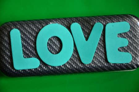 word loveon a green photo