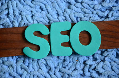 word seo on a abstract background photo