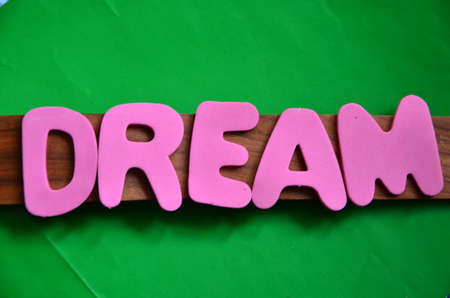 word dream on a green photo
