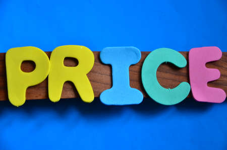 discounting: word price on a blue Stock Photo