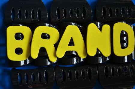 word brand on a black photo
