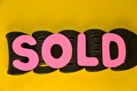 adjudicate: word sold on a yellow