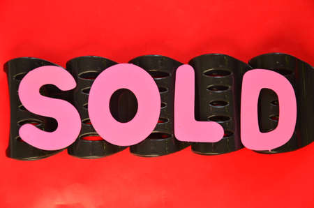 adjudicate: word sold on a red