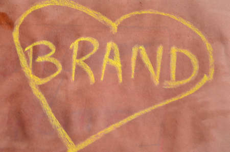branded product: brand written in chalk   Stock Photo