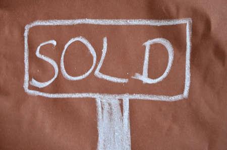 adjudicate: word sold written in chalk
