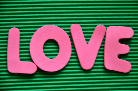 WORD LOVE ON A GREEN photo