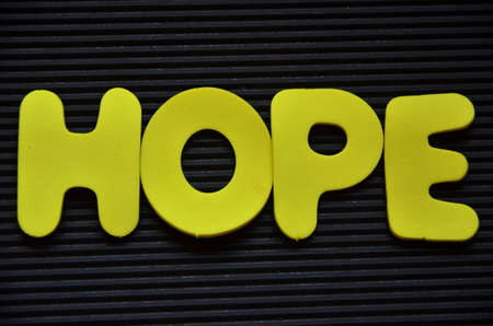hoping: word hope on a black