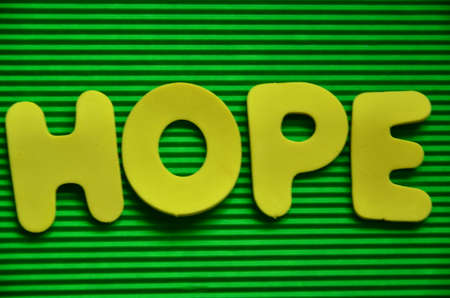 word hope on a green photo