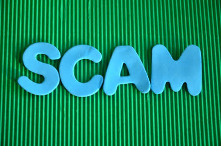 scamming: word scam Stock Photo