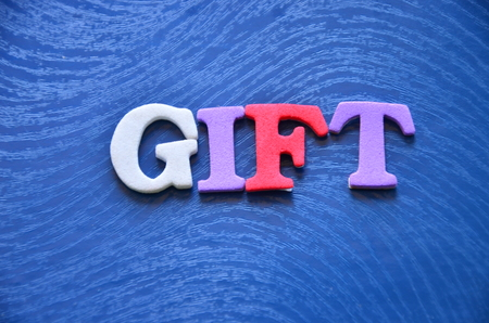 word gift on a blue  photo