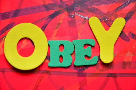 to obey: OBEY WORD Stock Photo