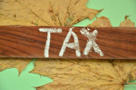 wage earners: TAX WORD Stock Photo