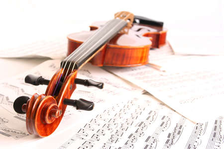 sonorous: White out violin on scattered sheet music Stock Photo