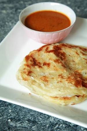 This is known as roti canai in Malaysia, a traditional Indian food.