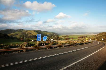 winding: Great Ocean Road, Victoria of Australia. Across the wild ocean and idyllic farmland.
