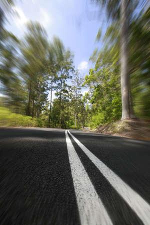 karri: Speeding through the majestic karri forest in Southwest region of Western Australia. Stock Photo