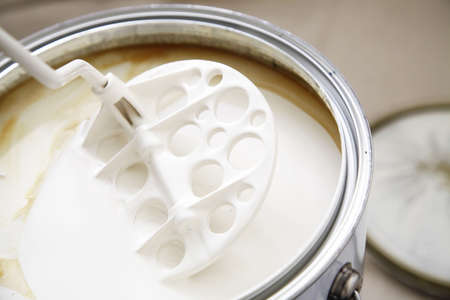 stirrer: A stirrer used to mix the oil based warm white paint.
