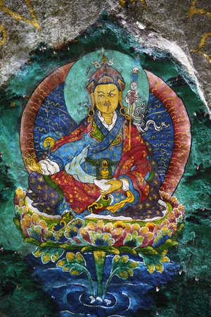 devout: This is Guru Rinpoche, known as Second Buddha in Bhutan. Devout Buddhists painted many sacred images on rocks, this is just one of them. This is a generic painting, not copyrighted.