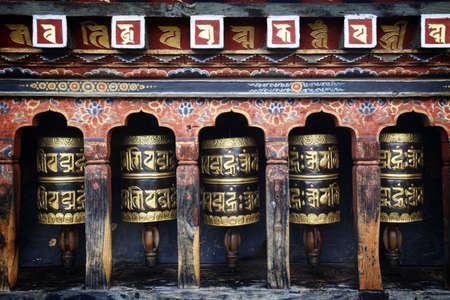 Mantra written on prayer wheels in Bhutan.