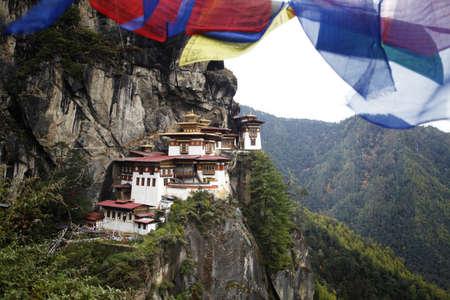 Prayer flags above the sacred Tatkshang Lhakang, Bhutan. Stock Photo - 8283760
