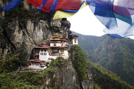 nest: Prayer flags above the sacred Tatkshang Lhakang, Bhutan.