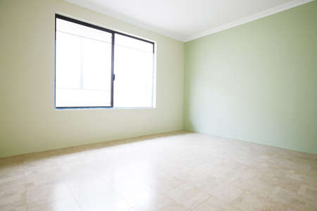 flooring cork: Empty room with cork flooring with green walls