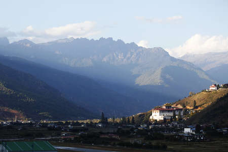 Ray of light falling upon Paro Dzong, Bhutan.