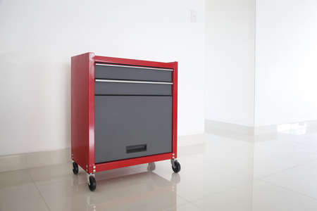 mechanic tools: Metal solid red tool box on white background