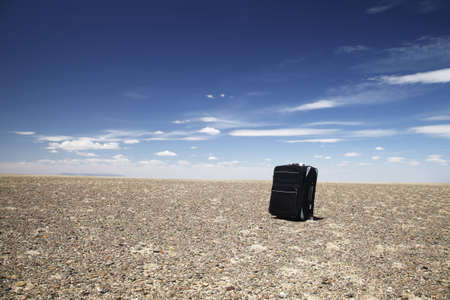 A black lone travelling baggage in Gobi desert, Mongolia. Stock Photo - 14240703