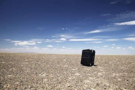 A black lone travelling baggage in Gobi desert, Mongolia. Stock Photo - 14240703