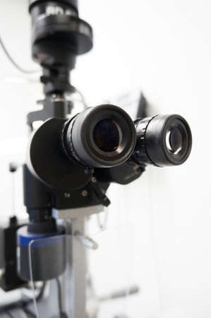 Detail and high key picture of a slit lamp used for eye examination. Stock Photo