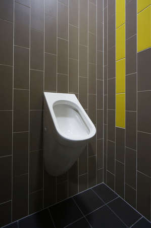 Designer toilet on dark tiled retro background.  Stock Photo - 19400926
