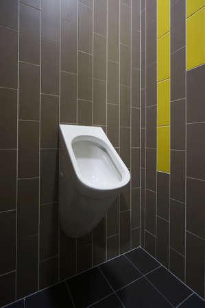 Designer toilet on dark tiled retro background. Stock Photo - 19400926