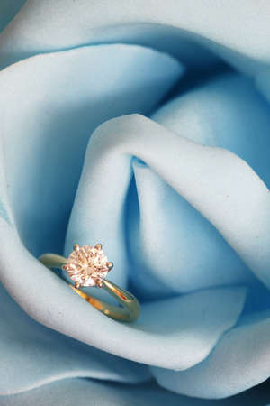 rose ring: Solitaire engagement diamond ring (ideal cut) encrusted on 18K gold ring embedded in blue rose.