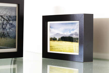 Photo frames with pictures inside - all photographs are taken by the current artist (no release required).  Stock Photo