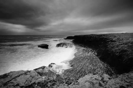 rendition: The dramatic and wild black and white rendition of Western Australian coast line.