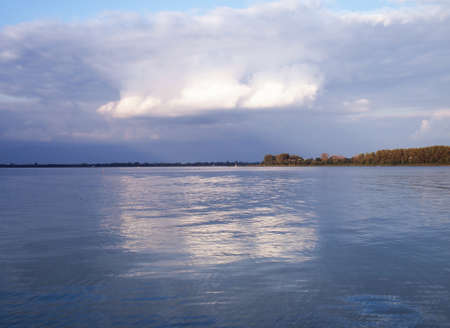 Beautiful clouds hover over the lagoon with blue water