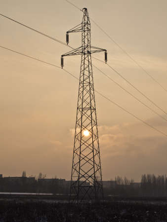 High voltage pole standing on the field
